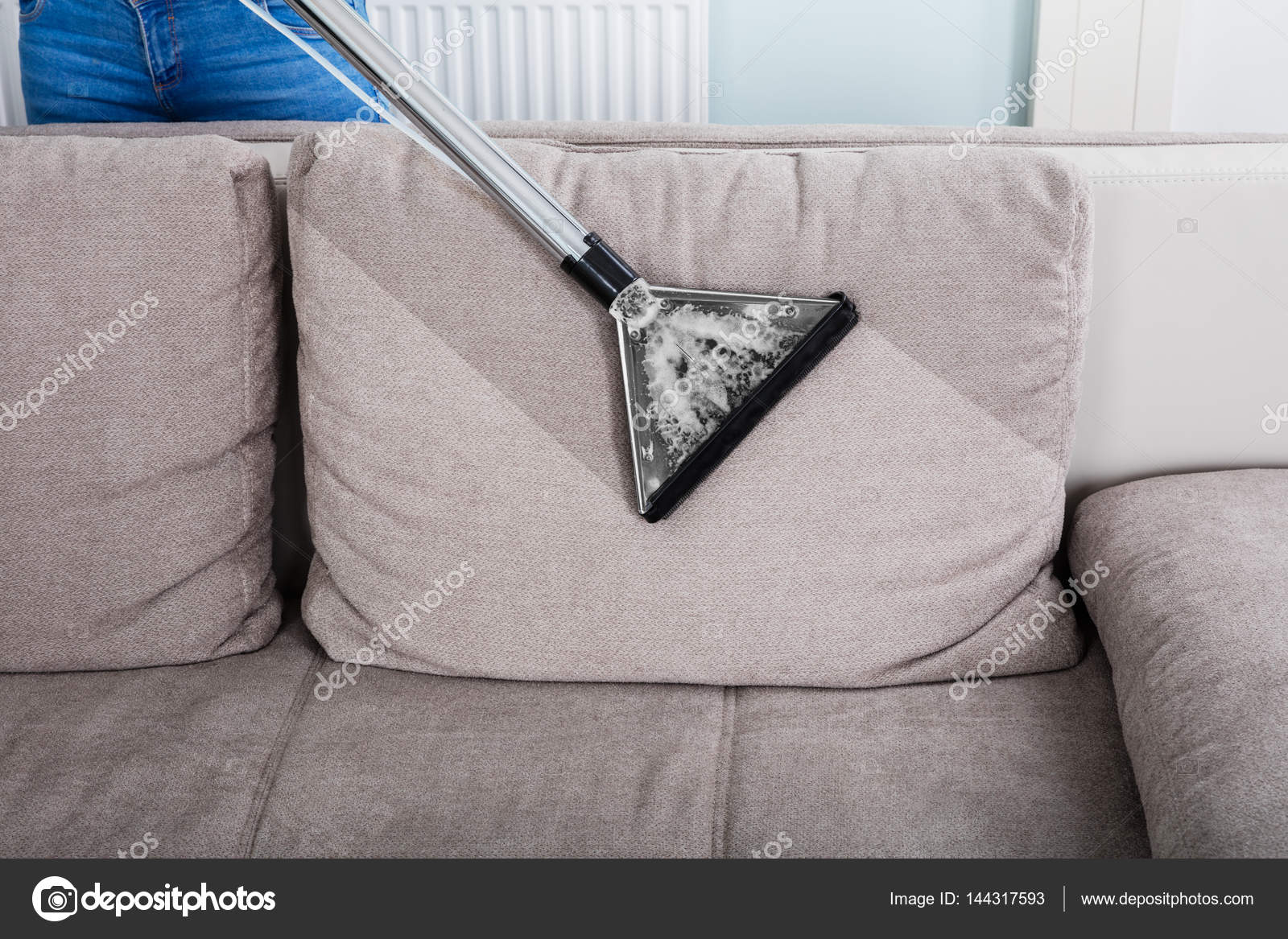 Woman Cleaning Sofa With Vacuum Cleaner U2014 Stock Photo