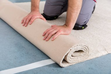 Hands Rolling Carpet