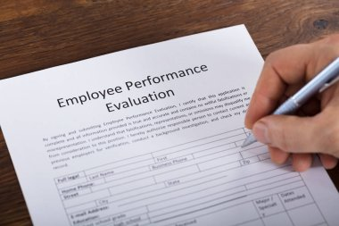 Person Filling Performance Form