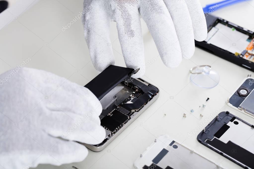 Person Repairing Cellphone