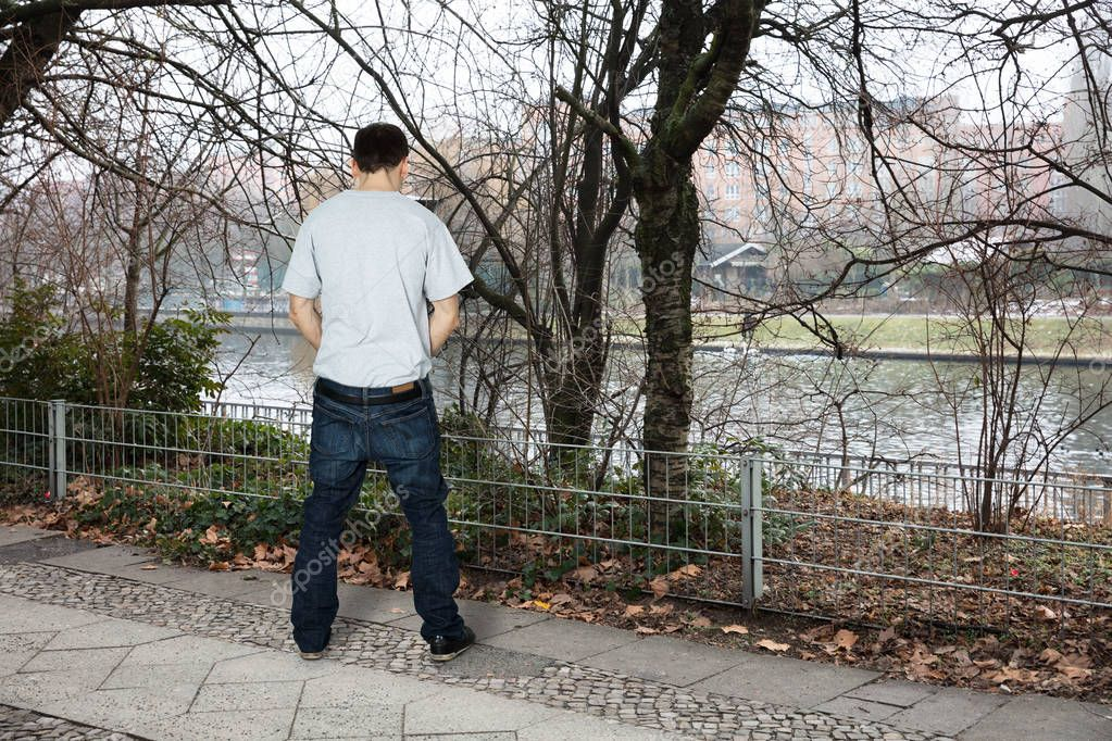 Man Peeing Outside