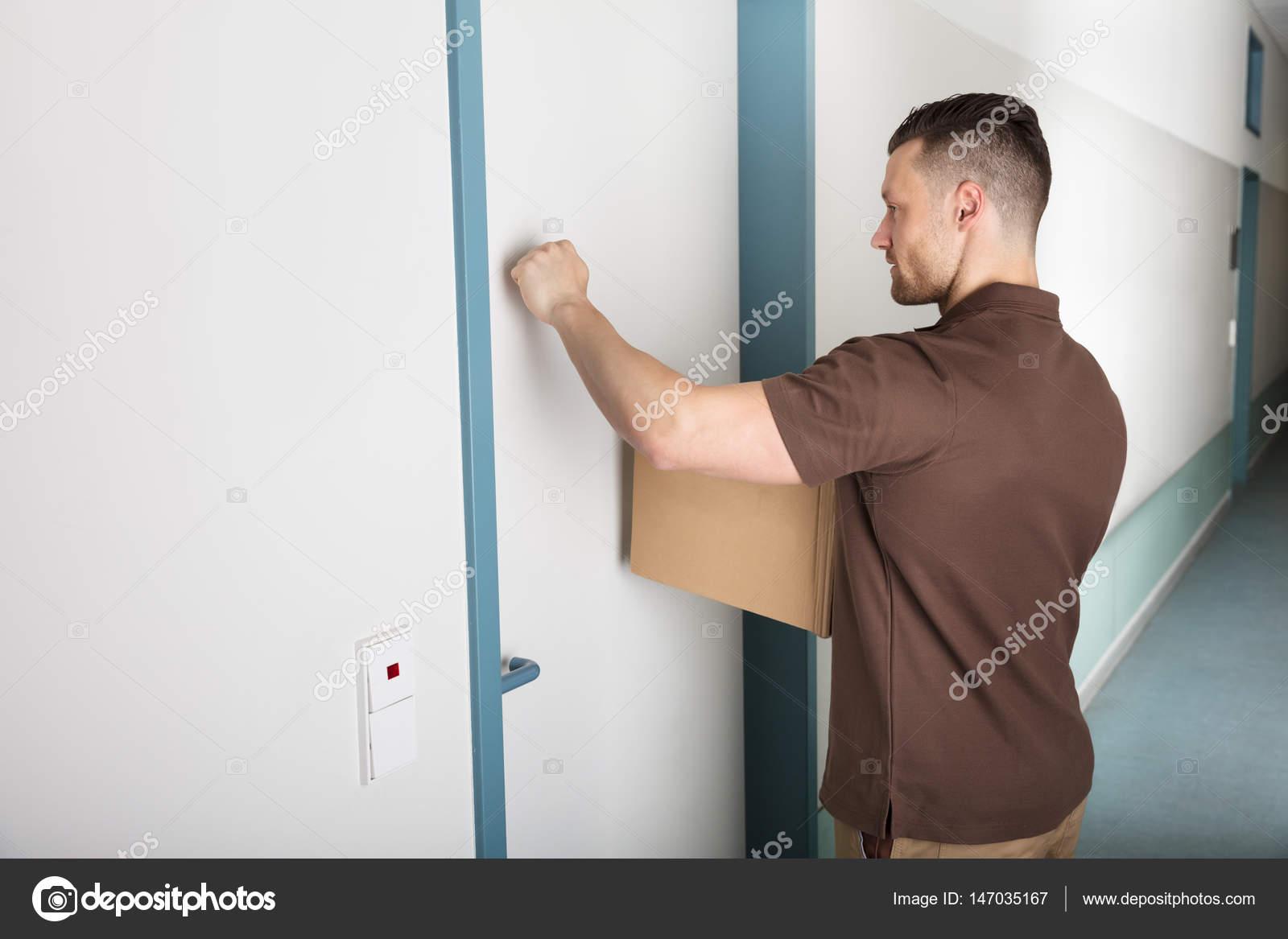 Delivery Man Knocking Door — Stock Photo © AndreyPopov