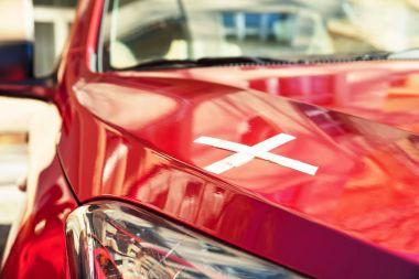 Bandage On Red Car