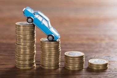 Car Model Over Stacked Coins