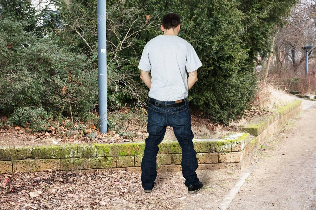 Man Peeing Outside