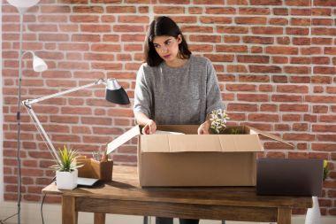 Young Employee Packing Box