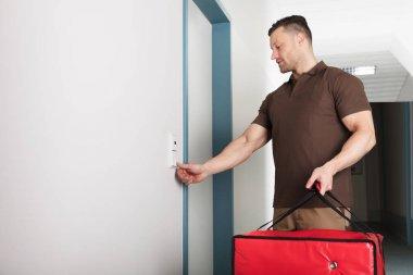 Delivery Man Ringing Door Bell