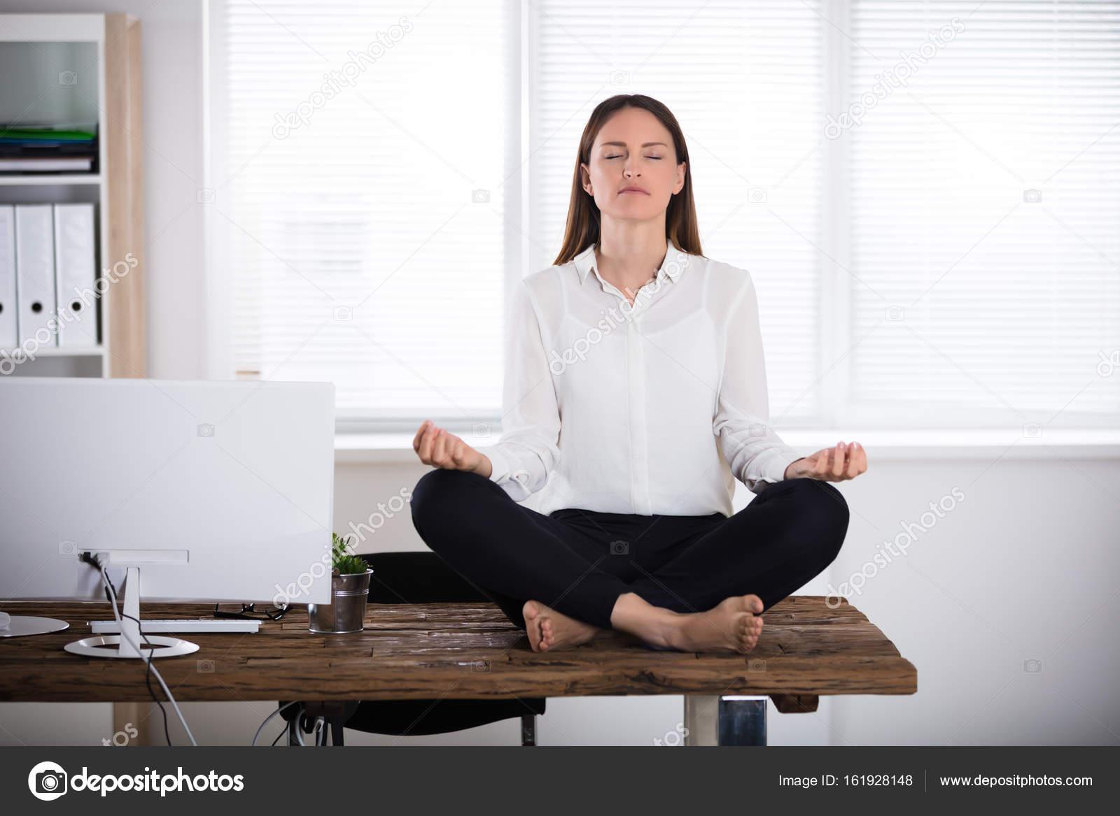 meditation office. Businesswoman Meditating In Office \u2014 Stock Photo Meditation