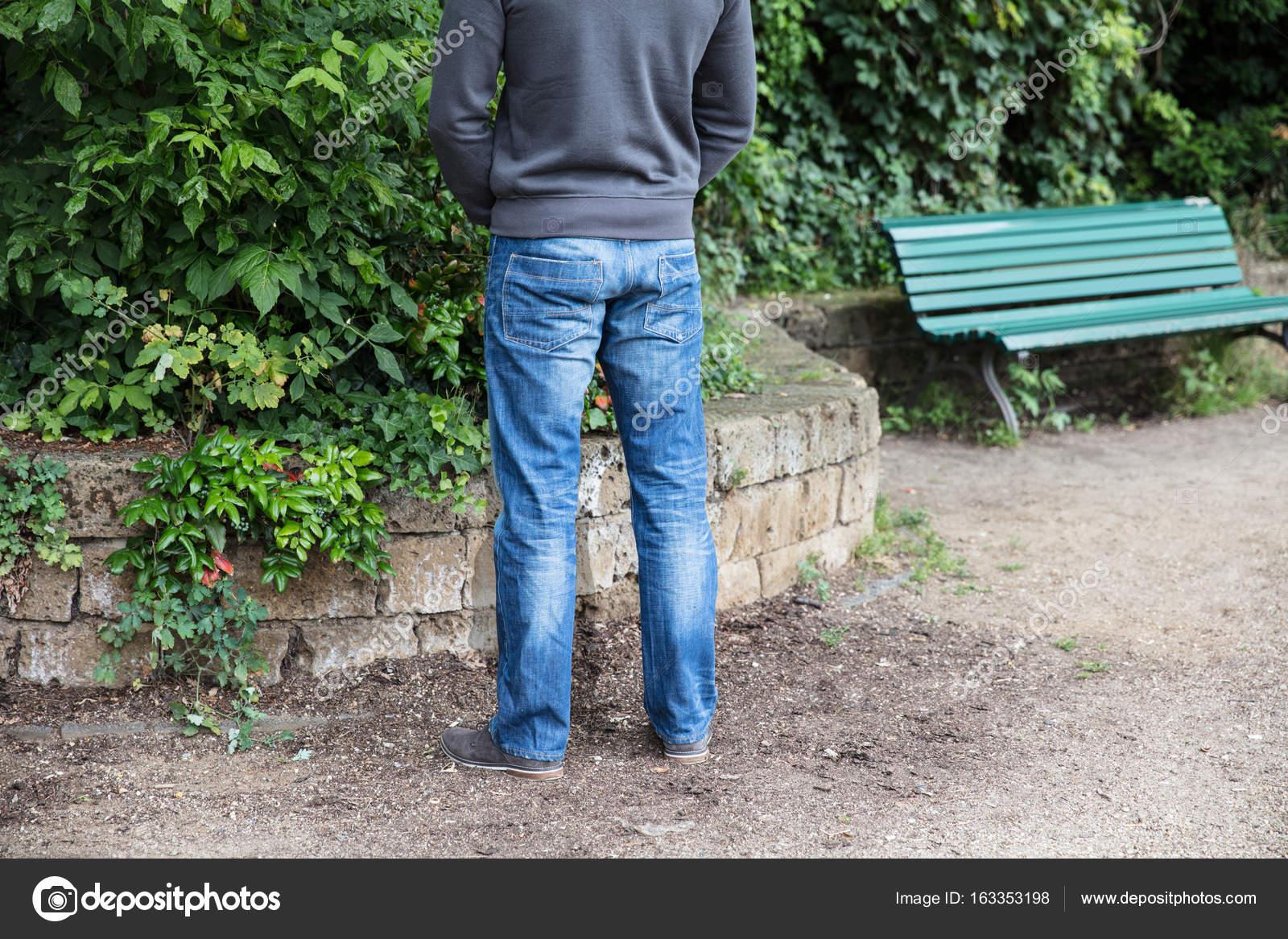 Man Peeing In Park — Stock Photo © AndreyPopov #163353198