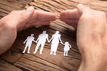 Businessman Covering Paper Family