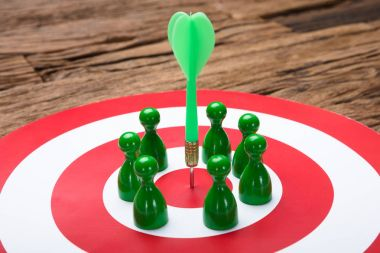 Green Paper Team Surrounding Arrow