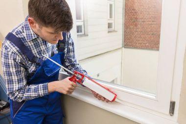Worker Applying Glue