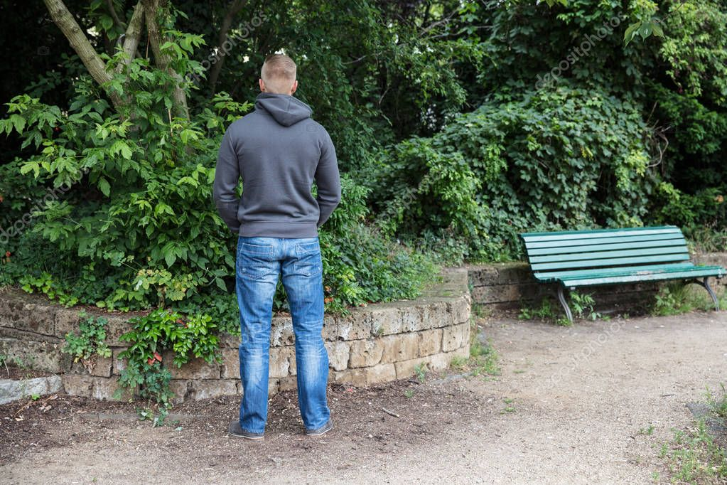 Man Peeing In Park