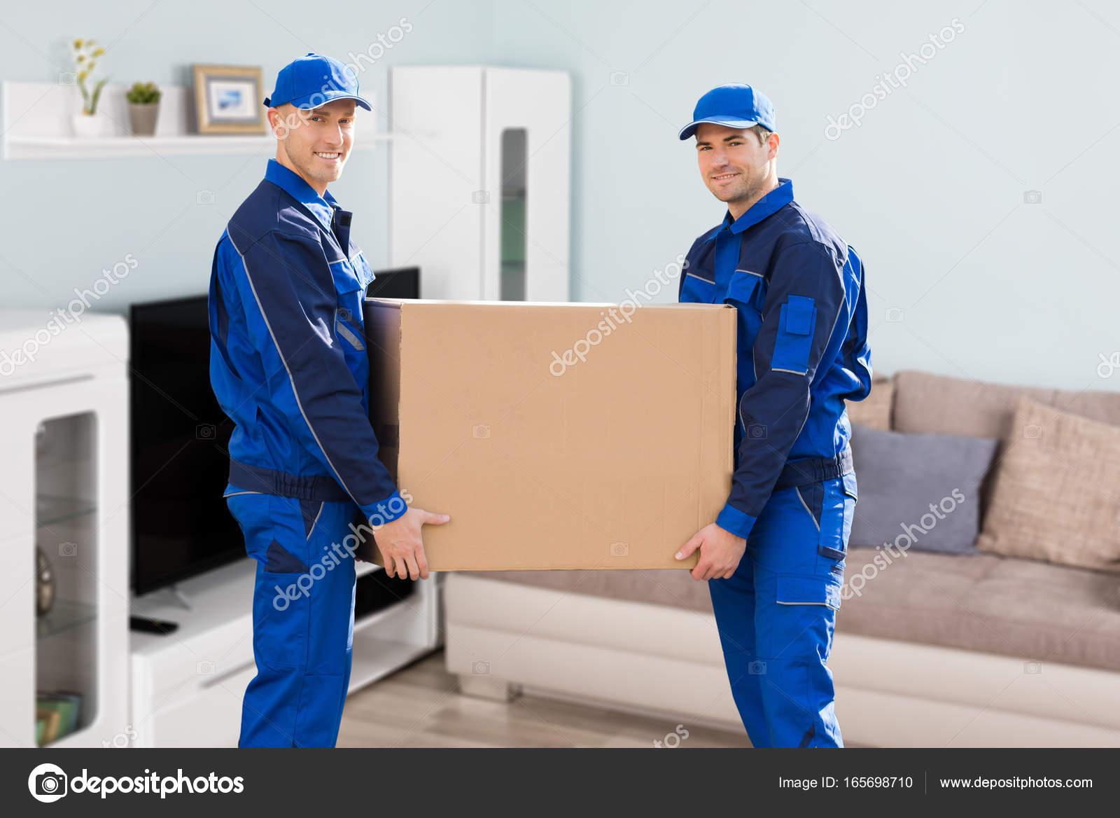 Mover liefern Karton — Stockfoto © AndreyPopov #165698710