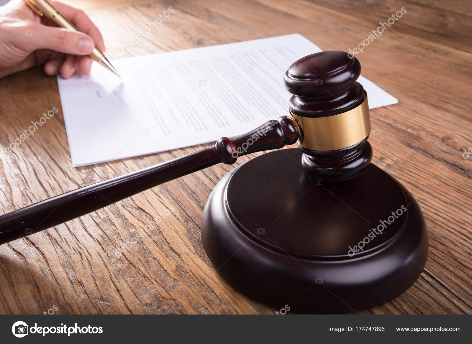 Person Signing Legal Document Stock Photo AndreyPopov - Signing legal documents