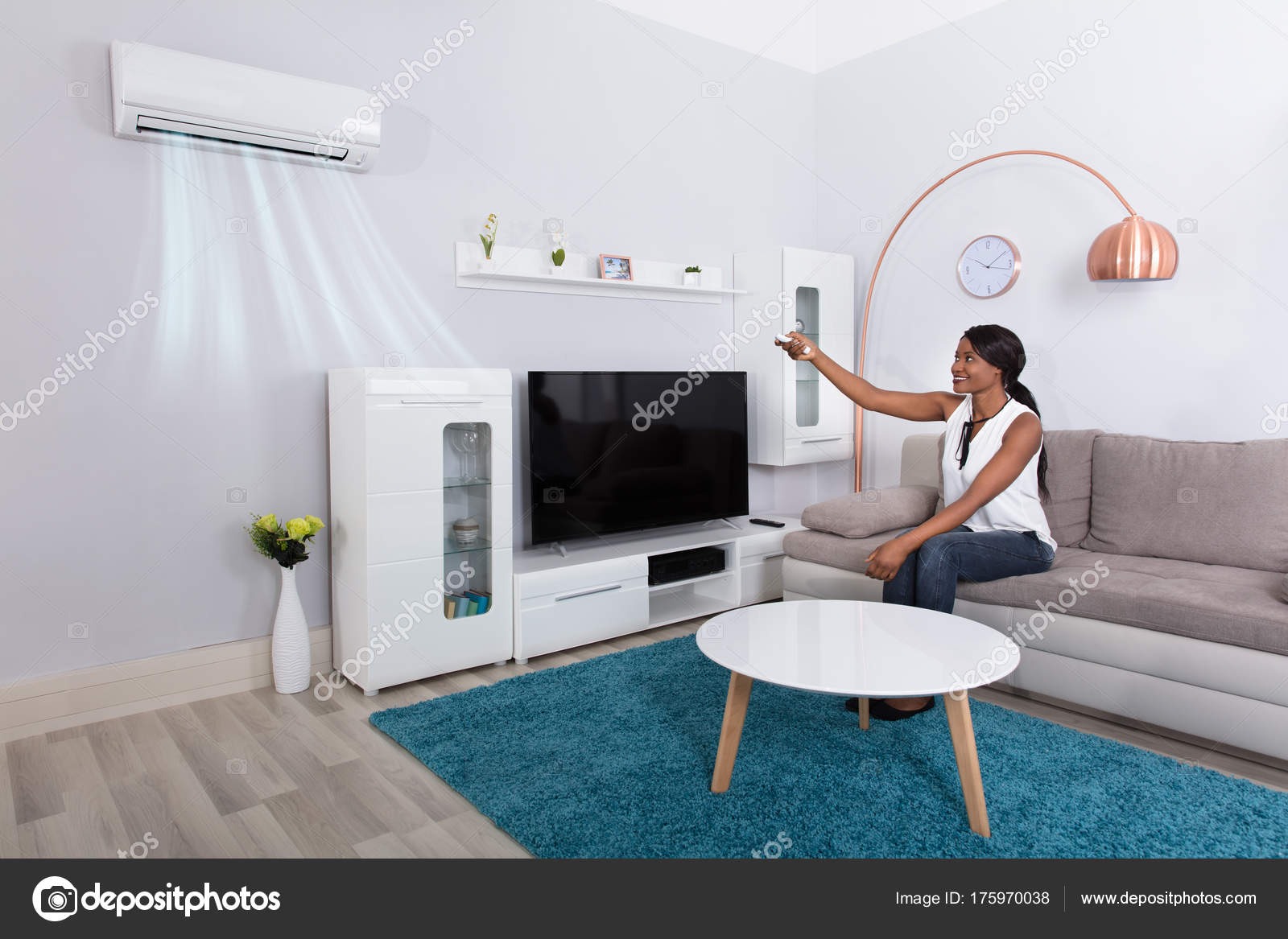 Woman Using Air Conditioner — Stock Photo © AndreyPopov #175970038