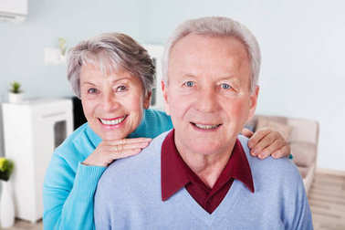 Portrait Of A Smiling Senior Couple At Home
