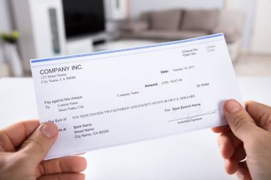 Close-up Of A Person's Hand Holding Cheque