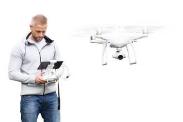 Young Man Operating Drone On White Background
