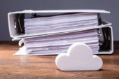 Fotografie Close-up Of Clouds Block In Front Of Folders On The Wooden Table