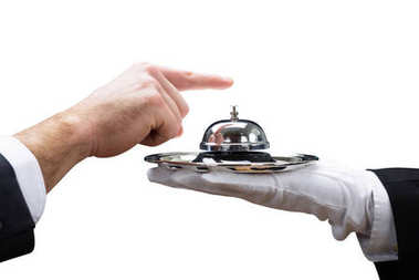 Customer's Hand Ringing Service Bell Held By Waiter On White Background