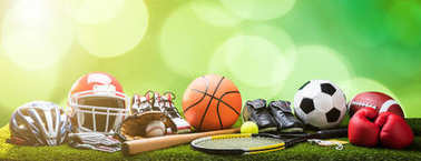 Close-up Of Various Sport Equipments On Pitch Against Bokeh Background stock vector