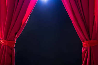 Close-up Of A Red Curtain Against Dark Background