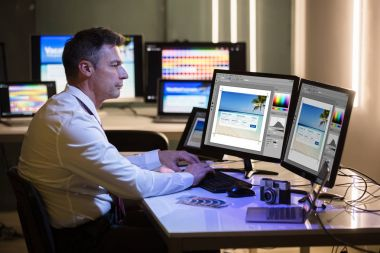 Side View Of A Male Designer Editing Photo On Computer