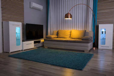 Illuminated Electric Light With Couch And Television In Living Room