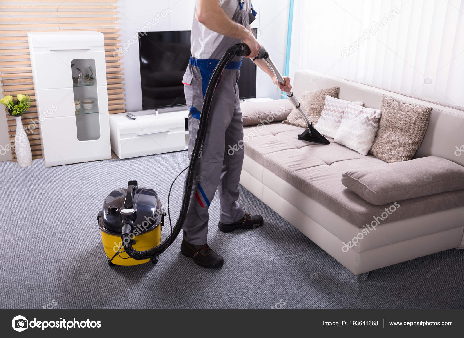 Man Cleaning Sofa Living Room Using Vacuum Cleaner Home U2014 Stock Photo