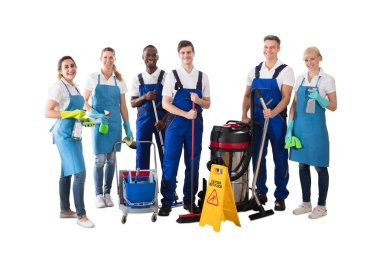 Diverse Group Of Professional Janitor Standing With His Cleaning Equipment Against White Background