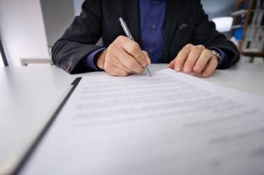 Close-up Photo Of An Businessperson Signing Contract stock vector