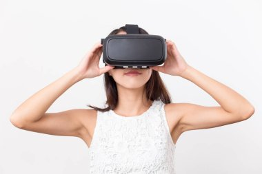 Woman watching though virtual reality glasses