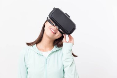 Woman looking through VR device
