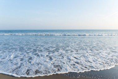 Sea waves at sandy beach