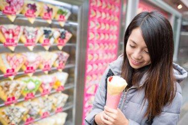 Asian woman enjoy cream crape