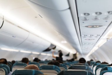 Plane cabin interior with passengers