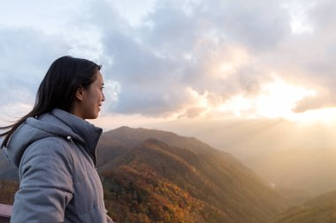 Woman looking at sunset on mountain