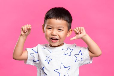 Excited cute asian boy