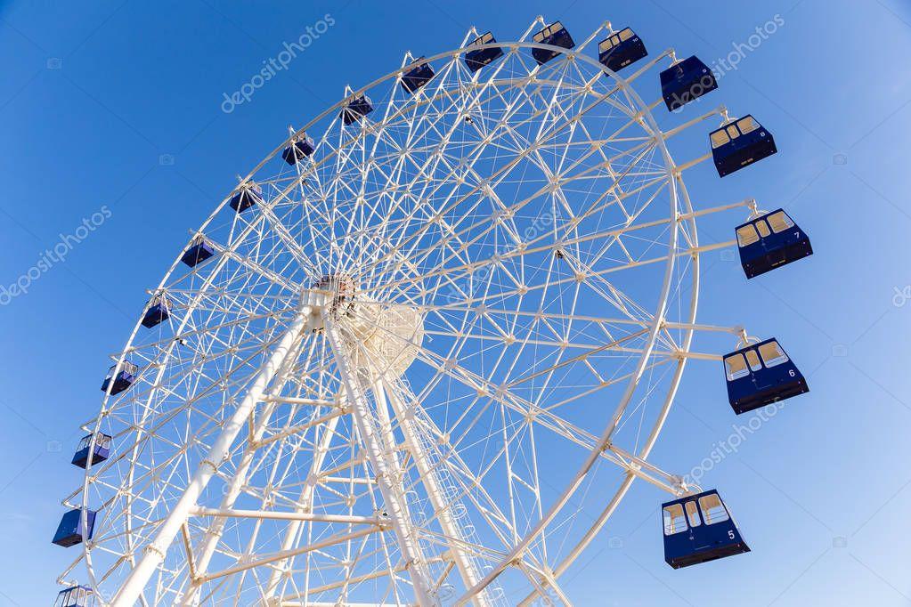 Ferris wheel under sunshine
