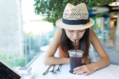 Woman enjoy coffee in cafe