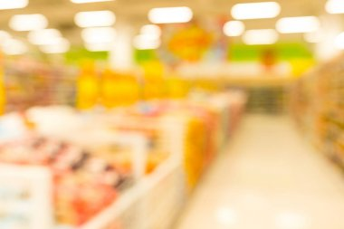 Customer shopping at supermarket store with bokeh light