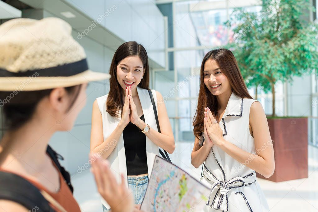 Woman say good bye in Thailand