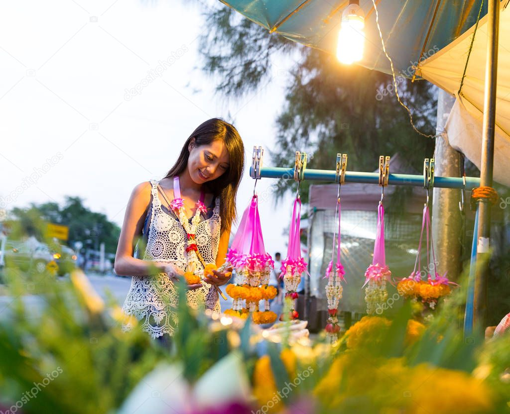 Woman buying flowers at hawker