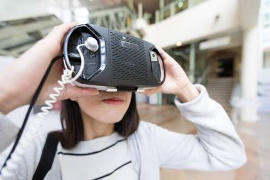 Woman looking with virtual reality