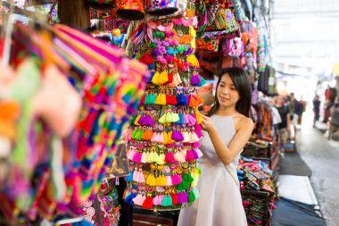 Woman enjoy shopping in weekend market
