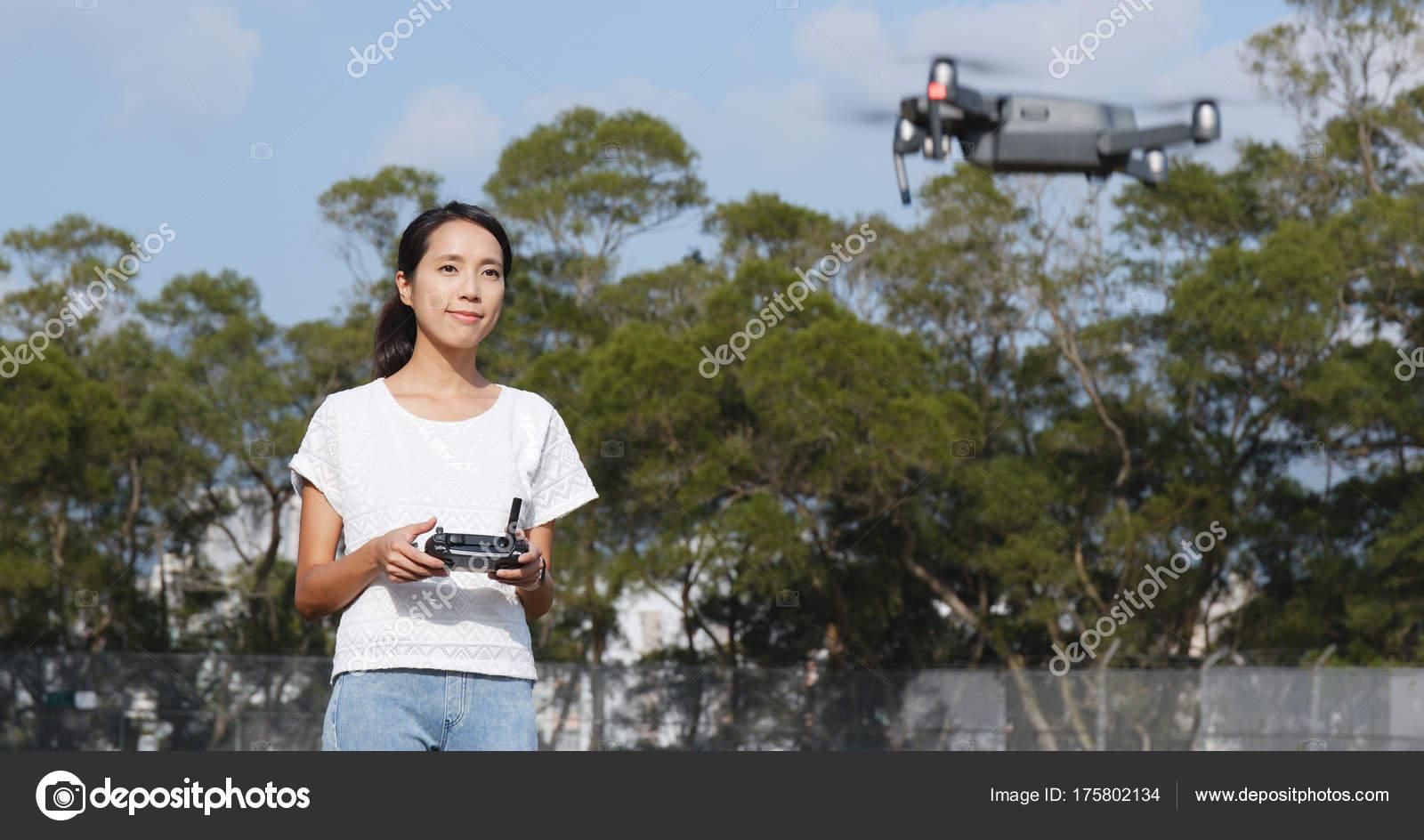 Woman Control Fly Drone Outdoor — Stock Photo © leungchopan