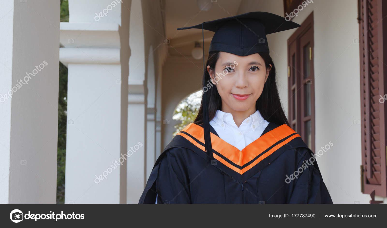 Young Woman Wearing Graduation Gown — Stock Photo © leungchopan ...
