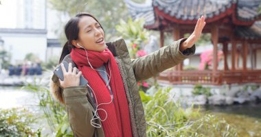 Woman listen to music and follow the song to singing out