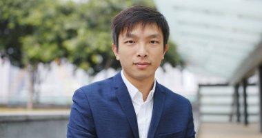 Asian Businessman smiling to camera
